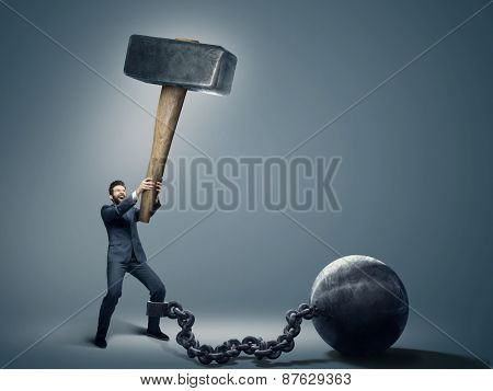 Conceptual image of a businessman holding big hammer