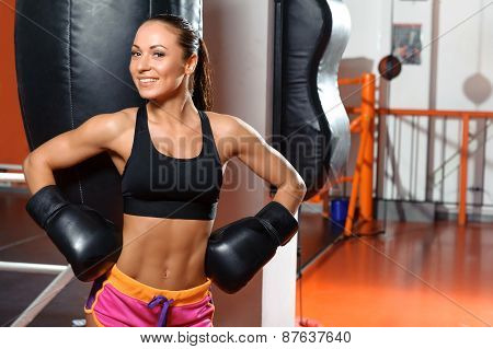 Female boxer with punching bag