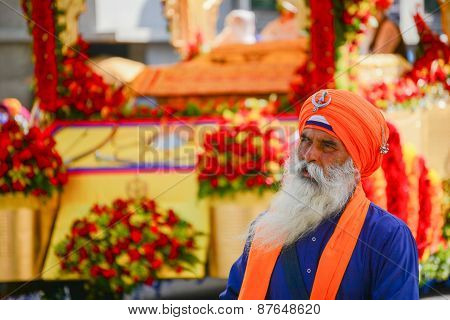 Devotee Sikhs With Orange Turban Marching