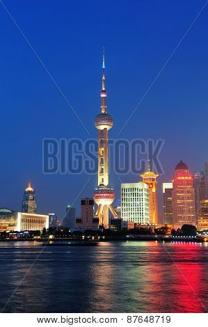 SHANGHAI, CHINA - JUNE 2: Oriental Pearl Tower over river on JUNE 2, 2012 in Shanghai, China. The tower was the tallest structure in China excluding Taiwan from 1994~2007 and the landmark of Shanghai.