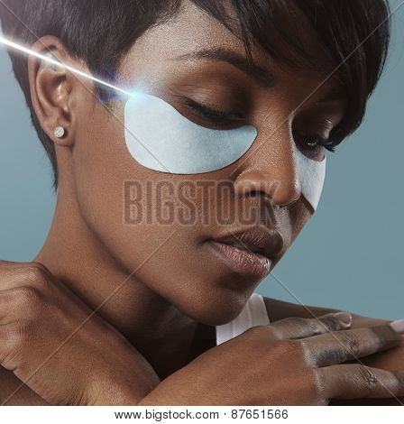 Woman With En Eye Patches And Ray Of Laser