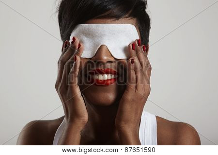 Woman In A Process Of A Fecial Treatment With An Eye Mask