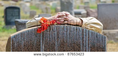 Lone Figure Of Person Grieving At Cemetery