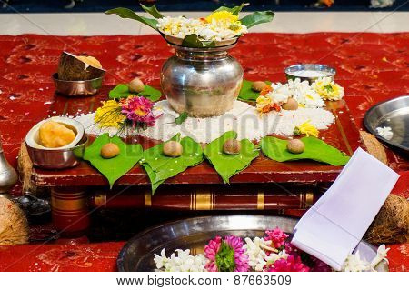 Selection of offerings given to the gods to bless an indian wedding. This usually consists of flowers food and a fire poster
