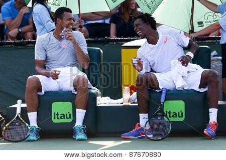 KEY BISCAYNE, FL-MAR 26: Jo-Wilfried Tsonga (L) and Gael Monfils of France between games during day four of the Miami Open at Crandon Park Tennis Center on March 26, 2015 in Key Biscayne, Florida.