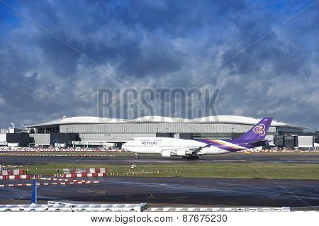 Thai Airways Plane Taking Off With Cloudy Sky In Background
