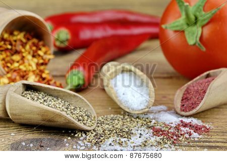 Tomato, Chili Pepper, Salt And Pepper On Rustic Wood Table