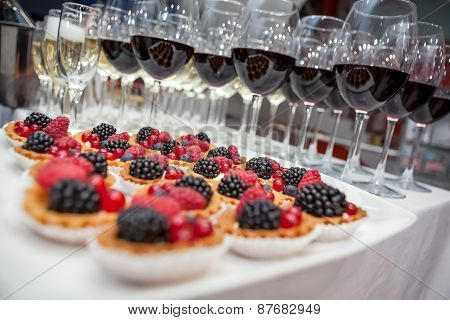 Festive buffet at the event with desert champagne and wine. Soft focus poster