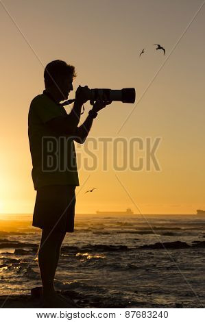 Silhouetted Nature Photographer