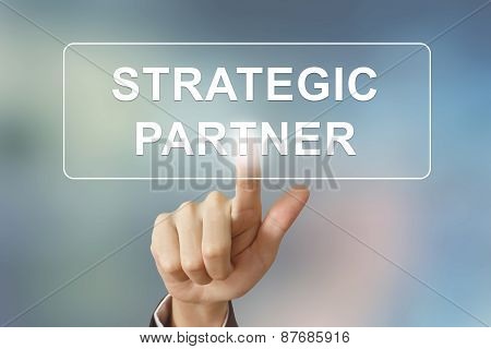 Business Hand Clicking Strategic Partner Button On Blurred Background
