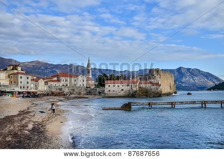 Budva Beach Near Old Town Wall And Fortress