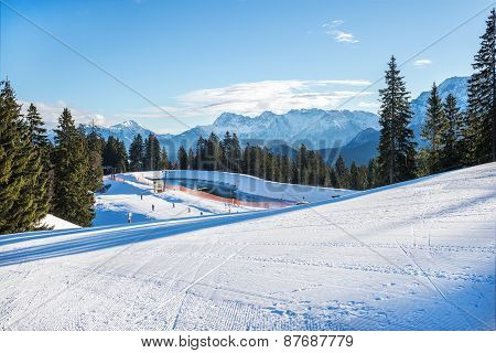 ski resort Bavarian Alps Germany. Mountain skiing slopes skiing at Hausberg top near Garmisch-Partenkirchen town in Bavarian Alpes in Germany on a clear winter day poster
