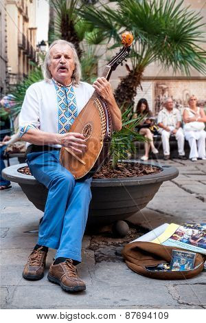 Street Musician With Lute In Barcelona