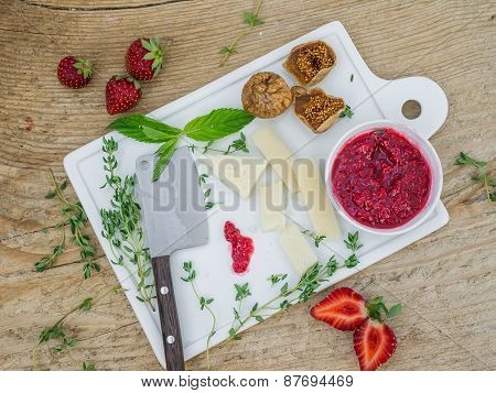 Cheese And Fruit Set On A Wooden Surface