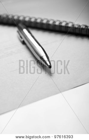 Pen and contract papers on wooden desk. poster