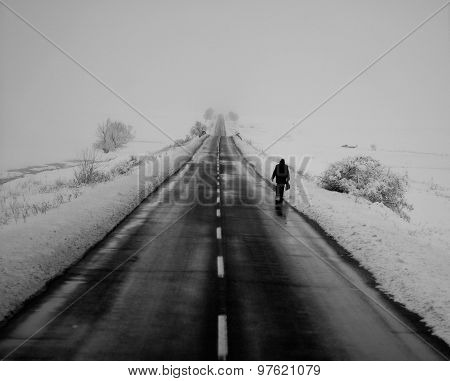 Lonely snowy road in winter