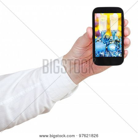 Businessman Holds Handphone With Xmas Still Life