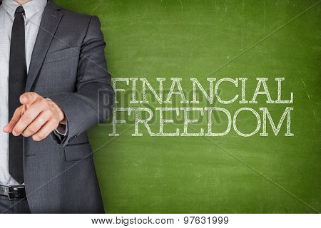 Financial freedom on blackboard with businessman