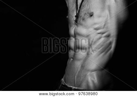 Muscular and sexy torso of young sporty man with perfect abs close up. Black and white poster