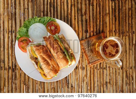 Chicken Baguette On Plate On Bamboo Table