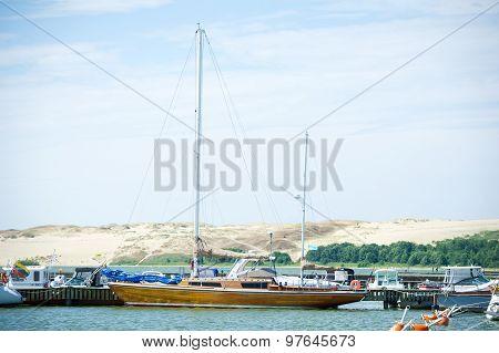 Luxury wooden yacht in Nida Harbour