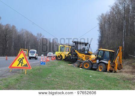 Simferopolskoye Highway, Moscow region, Russia, April, 27, 2015: the technician, taking part in works on reconstruction of Simferopolskoye Highway in the Moscow region, Russia