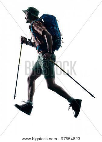 one caucasian man trekker trekking running happy  in silhouette isolated on white background