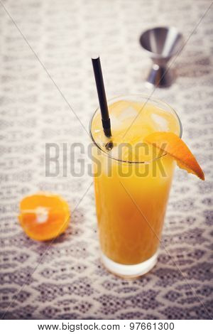 Retro Orange Cocktail Drink On Lace Tablecloth