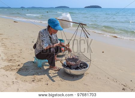 Asian Woman Selling Seafood On A Beach