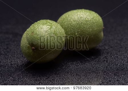 Green Nuts With Water Drops