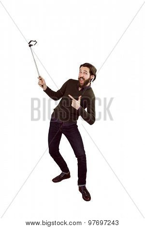 Hipster using his seflie stick on white background