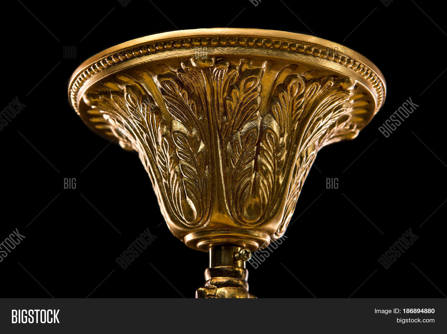 Top Cap Of Chandelier Contemporary Gold Isolated On Black Background Close Up