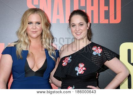 LOS ANGELES - MAY 10:  Amy Schumer, Kim Caramele at the