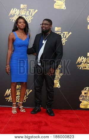 LOS ANGELES - MAY 7:  Brittany Marie Batchelder, Lil Rel Howery at the MTV Movie and Television Awards on the Shrine Auditorium on May 7, 2017 in Los Angeles, CA