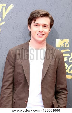 LOS ANGELES - MAY 7:  Nick Robinson at the MTV Movie and Television Awards on the Shrine Auditorium on May 7, 2017 in Los Angeles, CA