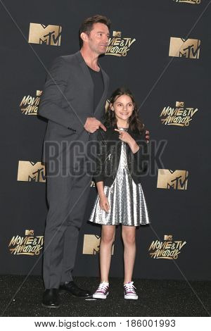 LOS ANGELES - MAY 7:  Hugh Jackman, Dafne Keen at the MTV Movie and Television Awards on the Shrine Auditorium on May 7, 2017 in Los Angeles, CA