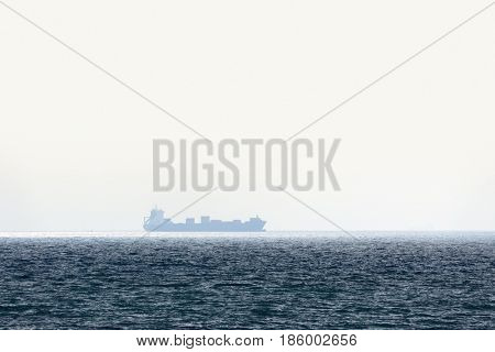 Alone barge in tranquil sea