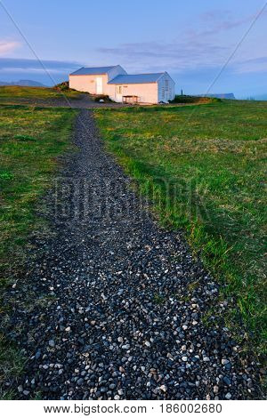 Small house of lighthouse keeper on Dyrholaey Nature Reserve, Iceland, Europe.