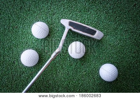 Mini golf scene with ball and club. Can be used like background. Sunny day at resort park
