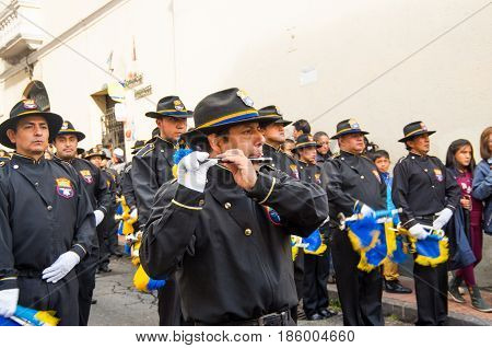 Quito, Ecuador - December 09, 2016: An unidentified people are playing flute in parade in Quito, Ecuador.