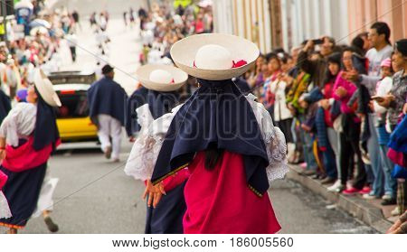 Quito, Ecuador - December 09, 2016: An unidentified dancers in parade in the streets of Quito, Ecuador back view.