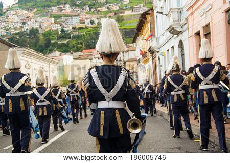 Quito, Ecuador - December 09, 2016: People with costumes are marching in streets during a parade in Quito, Ecuador.