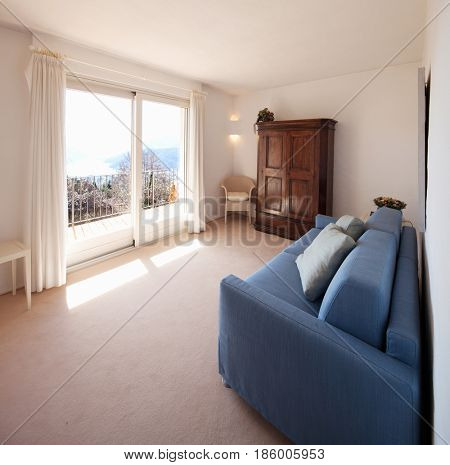 Small white room with beautiful landscape of Lugano