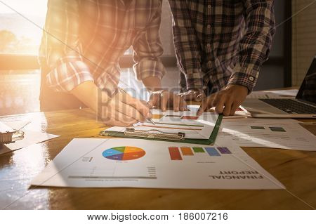 Business Adviser Analyzing Financial Figures Denoting The Progress In The Work Of The Company. Group