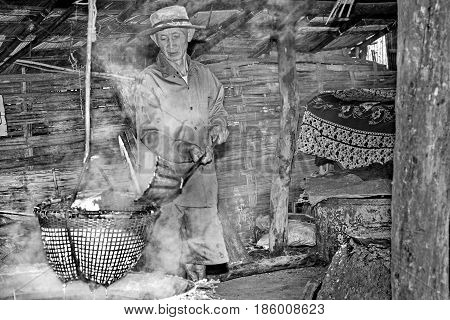 Nan Thailand Dec 9-2016 Villager lap crystallized salt from boiled saltwater to dried in basket. Nan Thailand. Selective focus in black and white.