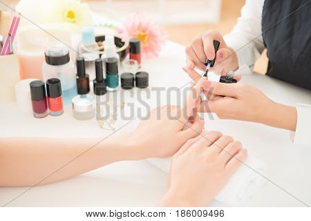 Hands Applying Transparent Nail Polish
