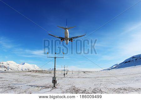 LONGYEARBYEN, SVALBARD, NORVAY - APRIL 19, 2013: SAS - Scandinavian Airlines Boeing 737-800 LN-RRE landing at Svalbard airport.