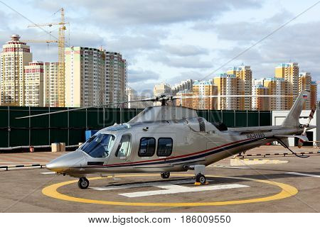 CROCUS EXPO, MOSCOW REGION, RUSSIA - OCTOBER 6, 2013: Private Agusta Westland A109 helicopter RA-01985 at Crocus airfield.