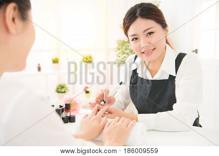 Manicurist Is Applying Electric Nail File Drill