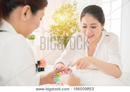 Woman Choose Manicure Colorful Nail Polish